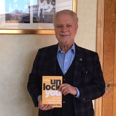 David Gold holding Unlock You book